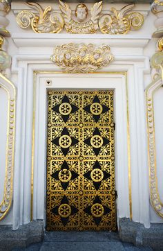 A super ornate door and frame make for a dramatic entrance.