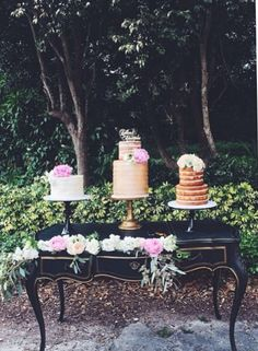 A trio of wedding cakes at Deering Estate by Cloud 9 Bakery in Miami | www.cloud9bakerycafe.com gold wedding cake naked wedding cake rustic vintage gatsby southern