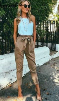 Turquoise top, brown skinny pants, beige shoes