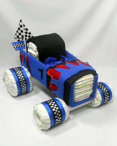 VROOM VROOM ... This Race Car Diaper Cake is ready for Laps at your next Baby Shower. Perfect Baby Gift for Race Car Fans. Awesome Baby Shower Centerpiece that is loaded with essential baby items every parent will need for their new baby. Includes: 60 size one diapers, 2 receiving