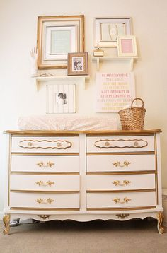 Love this refinished dresser with the grouping of prints on the wall. #girlydresser #creamnursery