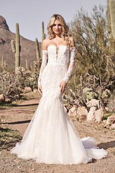 Show off your style in this boho chic mermaid wedding gown. Featuring a trendy strapless neckline with an illusion notch and detached off-the-shoulder long sleeves. Sequined embroidered lace Appliqués are placed over a sequined net underlay detailed with a floral motif. Paired with a full tulle skirt for a dramatic finish. The sleeves are included and are also available separately as 66164SL. Perfect Wedding Dress, Dream Wedding Dresses, Boho Wedding Dress, Designer Wedding Dresses, Wedding Gowns, Lace Wedding, Lillian West, Mermaid Gown, Lace Mermaid
