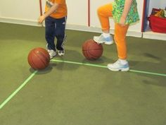 """Using feet to push the ball on the line - good article on developing large motor skills by playing """"on the line."""""""