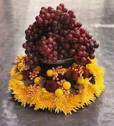 fall arrangement, grapes + mums