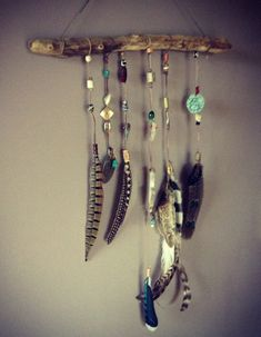 Driftwood Feather Mobile by CinagroFarm on Etsy, $48.50 www.artistdds.com