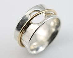 Fine Silver (99.9% silver, pure silver) band measures 1/2. True lovers knot ring made with 14k gold filled and fine silver spins around a textured band. Lovely ring!  Comes in size 5,6,7,8,9 and 10. I also do 1/2 sizes so please convo me.  Fine silver is 99.9% silver and is great for people with sensitive skin as it contains no copper or alloy! Fine silver keeps its shine longer and will not tarnish as quickly as sterling silver.  **SHIPPING INFORMATION**  All orders over $45 going ...