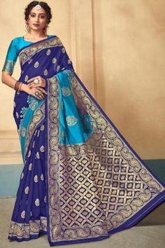 Dark Blue kanjivaram silk saree with peacock blue silk blouse. Embellished with woven zari. Saree with Sweetheart Neckline, Half Sleeve. It comes with unstitch blouse, it can be stitched 32 to 58 sizes. #saree #usa #silksaree #kanchivaram #andaazfashion