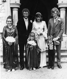This was my Aunty Lynnes wedding in about 1970. I am the small bridesmaid with the strange look! (apparently I had Measles at the time) Our dresses were bottle green satin from Biba. My brother doesn't look too happy either!