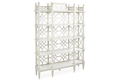 Chinese Chippendale styling gives this étagère grace and presence. The piece features four fixed shelves for storing and displaying books and accents. Botany Étagère, Light Gray
