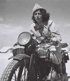A Haganah dispatch rider, Drora Harehuveni, on her motorcycle. Haganah was a Jewish paramilitary organization in what was then the British Mandate of Palestine from 1920 to 1948, which later became the core of the Israel Defense Forces.