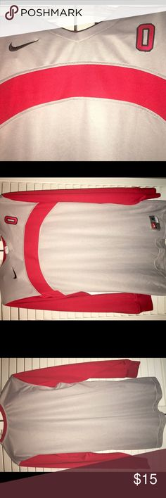 Ohio State Buckeyes Nike Dri-Fit women's shirt M Here's a great find for you Buckeye fans!  Perfect, pre-loved Nike DriFit shirt in size M.  The shirt is dove gray with a red insert across the chest, and embroidered Ohio O.  Black Nike swoosh and size tag on bottom.  Shirt has no stains nor pulls, is smoke free and super stylish.  Represent your Buckeyes at a fraction of the retail cost! Nike Tops