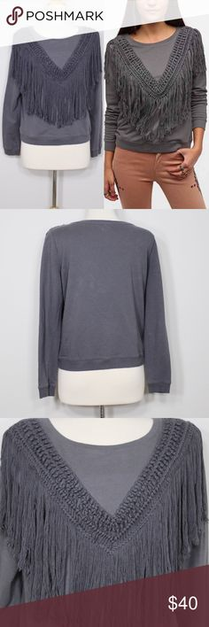 "Ecoté Wild Horses Fringe Sweatshirt Bust: 20"" (laying flat) Length: 22"" (shoulder to hem)  Super soft pullover sweatshirt from Ecote. Tonal fringe trim along the front body. Ribbed knit scoopneck, hem, and cuffs. Relaxed fit. Cotton. No holes or stains. Comes from a smoke free environment.  👌🏻Offers welcome through offer button 📦Bundles welcome ❌NO trades, please. ⚡️Same/Next day shipping Urban Outfitters Tops Sweatshirts & Hoodies"