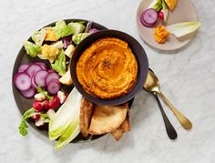 Recipe for: Roasted Carrot Hummus. This healthy twist on hummus might even be better than the original. It is perfect for a dinner party appetizer.