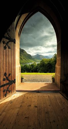 Afternoon light streaming through the arched door at the church of St Mary's and St Fillans at Glenfinnan, Scotland