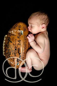 newborn football would be cool to have all the baby shower guests sign it first!! At whoever has a boy next you should do this!