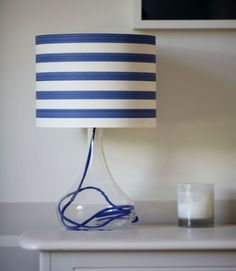 Made with striped wallpaper and a see-through lamp base. Nautical Lamps, Nautical Table, Diy Abat Jour, Rope Mirror, Ideias Diy, Rope Shelves, Striped Wallpaper, Cheap Home Decor, Home Decor Inspiration