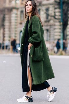 Try a hunter green duster coat over a skirt and sneakers