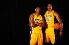Kobe Bryant and Dwight Howard of the Los Angeles Lakers pose during Media Day at Toyota Sports Center on October 1, 2012 in El Segundo, California.