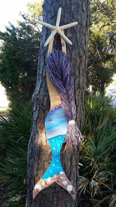 No two mermaids are alike!! Each mermaid is handmade with its own unique design! These would look great in any beach house, condo, or home!