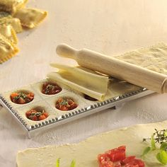 GEFU Ravioli Maker. This is great to prepare larger quantites of Ravioli.  Simply place a sheet of dough onto the flour-sprinkled ravioli maker and press down using the plastic mold.  Fill the wells with desired filling, place second sheet on top of filling.   Using enclosed roller, press and roll to seal.  Flip over and gently press out each of the 12 freshly made ravioli!  You control the ingredients and the nutritional value of the pasta!
