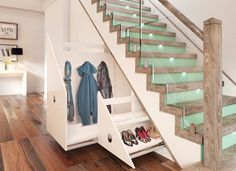 Staircase renovation in Dust Oak, clear and coloured glass with understairs LED lighting and StairStore pull-out units, from £2,000, James Grace