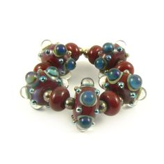 Handmade Lampwork Beads, Red and Puple Blue Silverglass Bead Set. €24.00, via Etsy.