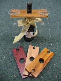 Wood wine glass holder over a wine bottle