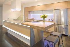 12 Bright and Elegant Kitchen Designs from Mal Corboy : Beige Natural Wood Modern Kitchen Design with Wooden Kitchen Cabinet and Wooden Floor