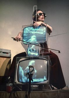 """science70: """"Charlotte Moorman performs Nam June Paik's TV Cello while wearing his TV Glasses, New York City, 1971. """""""