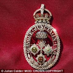 The Queen has a very special piece of jewelery she wears for her Birthday Parade – the Brigade of Guards Brooch. Created for Queen Mary, it features the badges of the five regiments of the Foot Guards. The motto, 'Quinque Juncta in Uno' ('Five Joined in One'), defines the unity of the brigades.