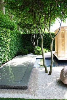 """ Stunning small space garden where zen and modern meet. High quality craftsmanship. Garden design Luciano Giubbilei, architect Kengo Kuma, and sculptor Peter Randall-Page. """