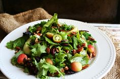 "Autumn Kale & Kiwi Berry Salad - I Thee Cook ~~ Only one hitch, I've never seen kiwi 'berries"". I imagine regular kiwi, peeled, would work just fine."
