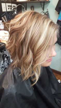Wavy blonde hair long angled bob! Hair by Telia @ Telia's cut and color a Paul Mitchell focus salon #blondes #longangeledbobs #naturalblondes #summercolors #hairbytelia #teliascutandcolor #paulmitchellthecolor