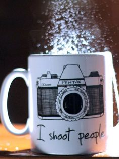 """This I Shoot People Novelty Mug is an otherwise ordinary white ceramic coffee mug from Twisted Envy. Ordinary, that is, apart from the fact that it has """"I Shoot People"""" printed on it below the image of a Pentax camera. My Coffee, Coffee Cups, Diy Becher, Tassen Design, Diy Mugs, Novelty Mugs, Cool Mugs, Funny Mugs, Mug Shots"""