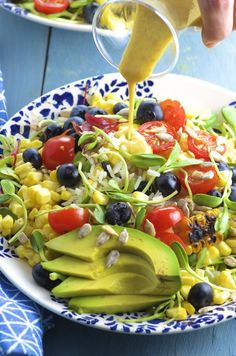 Fragrant rice, grilled corn, fresh blueberries and juicy tomatoes make this Summer Rice Salad a great side dish for any summer picnic or BBQ !