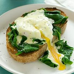 Early mornings are easier with Eggs Benedict Florentine on the menu for breakfast. Gently poached eggs sit atop sauteed spinach and toasted sourdough bread, and then drizzled with a homemade hollandai Eggs Benedict Florentine, Eggs Florentine, Egg Benedict, Egg Recipes, Brunch Recipes, Breakfast Recipes, Cooking Recipes, Healthy Recipes, Breakfast Items