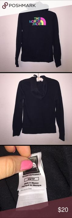 North Face Pullover Color is black with multi colored lettering! Size XS. No flaws! North Face Tops Sweatshirts & Hoodies