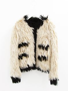 Fur. With the 90's came concern for working conditions and the environment. An anit-fur movement quickly followed. In response, critics claimed that faux fur is no better for the environment because it is synthetic, flammable, and not biodegradable. Despite the concerns, fur was still extremely popular, such as this Chanel jacket.