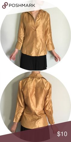Thick Fabric Collared Golden Button Down Polyester fabric made to look and feel like organic silk. Rich gold color with beautiful sheen. Perfect for work or office while still allowing you to make a fashion statement. Business casual. Shown on a S sized frame. Cropped sleeves, can be folded back as well. Vintage Tops Button Down Shirts