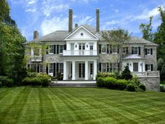 Greenwich, CT (of course).  Love this stone work with white siding and black shutters. Classic, never goes out of style.