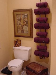 Wine rack as towel stand. Great for small bathrooms!!!