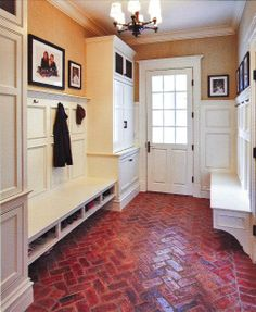 Handsome cabinetry gives front-door storage a formal elegance. Multiple layers and storage types offer closed and open storage, including plenty of seating with shoe storage below, cubbies for hats, gloves, and mail. Taunton's Built Ins Idea Book 2012