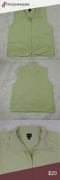 "Eileen Fisher fleece lined pastel green vest Eileen Fisher fleece lined pastel green vest In good condition Has some tiny light stains (pictured) And on the left shoulder has a little visible glue at the seam.(pictured) Still looks great. The first picture represents its true color. Measuments taken laying flat across: Armpit to armpit 21"" Waist 21.5"" Length 24.5"" from shoulder down Eileen Fisher Jackets & Coats Vests"