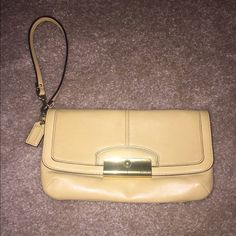 Coach small leather clutch wristlet Cute Coach wristlet/ small clutch. Fits quite a few items when you go out and adds a pop of color to the outfit. Coach Bags Clutches & Wristlets