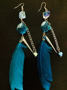 aaseagypsy jewels; blue who gypsy jangle festival feather earrings;
