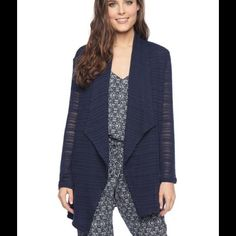 Splendid light knit open cardigan in navy From comfy-cool tees to cozy knit cardis, Splendid's luxe essentials make off-duty dressing a breeze. Draped open front, long sleeves, side slit pockets Polyester/rayon/spandex Dry clean Made in USA Web ID: 1134969 Splendid Tops