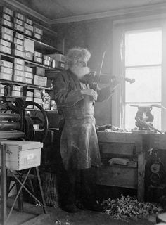 Petrus Norling, Knivsta, Uppland, Sweden    The shoemaker, woodcarver and fiddler Petrus Norling in Knivsta, playing the violin in his workshop. Photograph by: Einar Erici  Date: 1930s