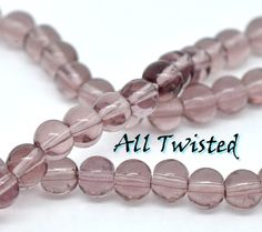 Mauve Round Glass Beads. Starting at $1 on Tophatter.com!