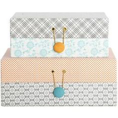 cover shoe boxes in fabric and add button
