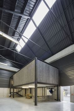 Image 15 of 31 from gallery of Adémia Office Building and Industrial Warehouse / João Mendes Ribeiro. Photograph by Nelson Garrido
